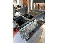 Integrated kitchen bins.