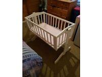White wooden swinging crib