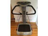Vibration plate exercise machine with stand