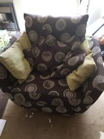 Reclining and swivel arm chair