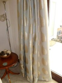 Two sets of lined curtains