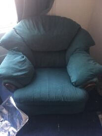 large green cosy armchair