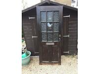 Wooden front door with glass.
