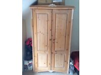 Marks & Spencer double wooden wardrobe for sale. Very good condition, pole, shelf, and mirror inside
