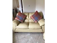 2 leather sofas and poufee