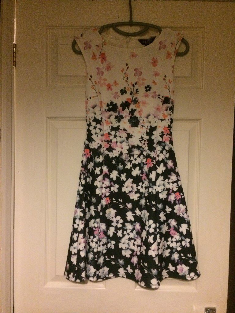 lipsy dressin Wantage, OxfordshireGumtree - brand new lipsy dress with tag on, cost £50 size 8 black white and pink poppy dress