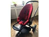 Quinny push chair in red