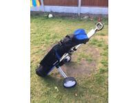 Half set of golf clubs with bag and trolley