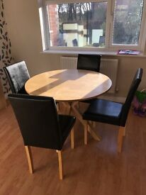 Round dining table with 4 chairs