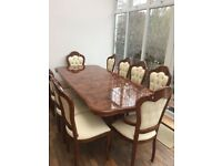 Top quality Italian extendable dining table and 10 chairs in immaculate condition.