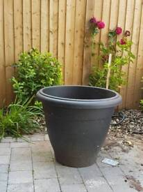 Large plastic planter pot