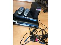 2 sky boxes and remotes