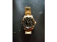 Rolex submariner, gold and black coloured, mens