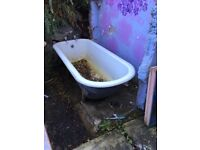 Old cast iron roll top bath