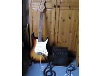 Rockburn strat style electric guitar, practice amp and lead