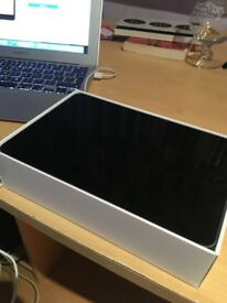 Ipad Mini 4 128gb. Used once. With 3 year warranty