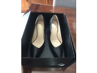 Womens black leather size 6 High heels