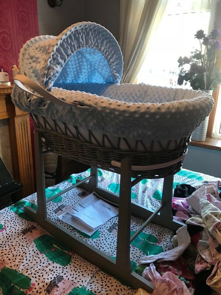 Blue wicker Moses basket with rocking stand BRAND NEWin Accrington, Lancashire - Blue wicker Moses basket with rocking grey stand Never used just built £30 Accrington Instructions & box available Wrapper still on the mattress