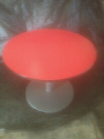 Red Round Wood Effect Table in Used Condition