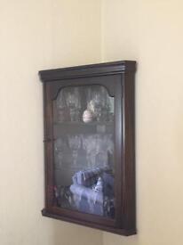 Small wall-mounted corner cupboard