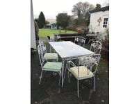 1950's/60's wrought iron garden table with glass top and 6 matching chairs