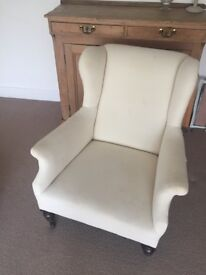 Lovely comfy antique wingback armchair in off white calico.