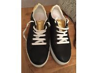 Hardly worn women's Diesal black and gold leather trainer shies
