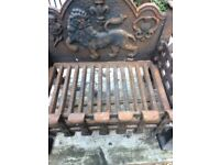 Cast iron fire grate approx 18 inches wide X11 inches depth needs wire brushing and blacking