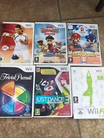 Nintendo wii with controller, games and wii fit boar