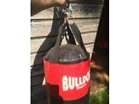 Heavy punch boxing bag £10; 2 x 15kg weights + 20kg barbell £25