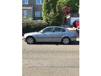 Silver BMW 320i 4 door saloon, MOT July