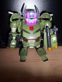 Transformer Bulkhead toy with shooting missiles, transforms into a truck.