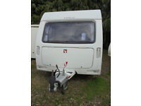 2012 Venus 500/4 4 Berth Touring Caravan With Fixed Twin Bunks And Rear Washroom.