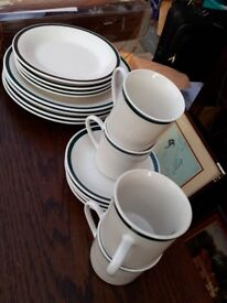 Green rimmed white dinner set. 16 piece