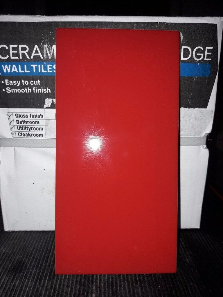 Ceramic bevelled edged wall tiles red.