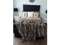 double faux leather bed complete with sprung mattress