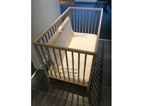 Children's cot with mattress