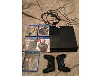 PlayStation 4 with 2 controllers, 4 games 1 Blu-ray DVD