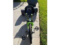 Green Huffy Machine go cart