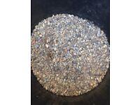 Decorative gravel for garden & black bin