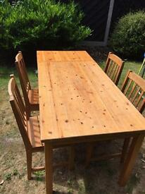 Dining Table Solid Pine, with 4 chairs .Extends to seat 8