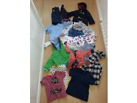 large bag of baby boy clothes up to 12 months of age