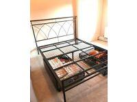 Black metal king size bed frame and bedside tables