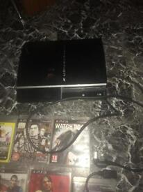 PlayStation 3 with controllers and games and charging wire