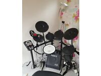 Roland Drum kit TD-11, with Roland speaker, headphones, amplifier and practice pad stand
