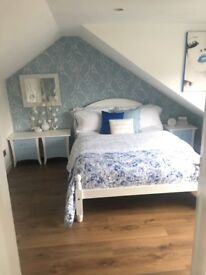 White wooden double bed complete with mattress