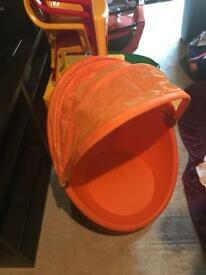 Child's orange egg chair from ikea