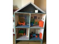 Solid wooden dolls house with furniture
