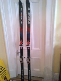 a pair of long vintage skis for a display or similar