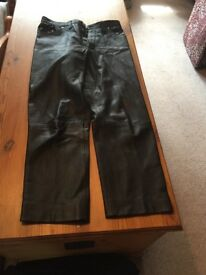 Women's black leather trousers with button fly
